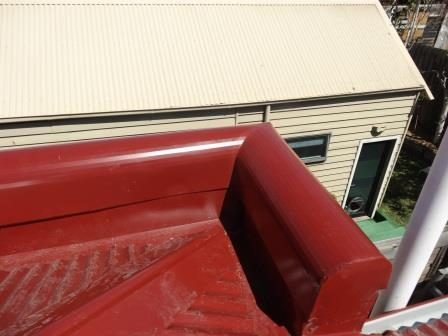 New corner parapet being installed (Manor Red colour)